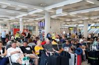 Passengers are seen at Mallorca Airport after Thomas Cook, the world's oldest travel firm collapsed, in Palma de Mallorca