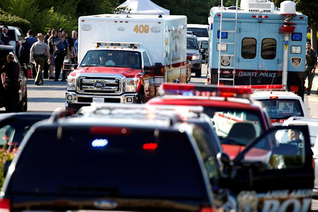 <p>Emergency response vehicles drive near a shooting scene after a gunman opened fire at the Capital Gazette newspaper in Annapolis, Md., June 28, 2018. (Photo: Joshua Roberts/Reuters) </p>