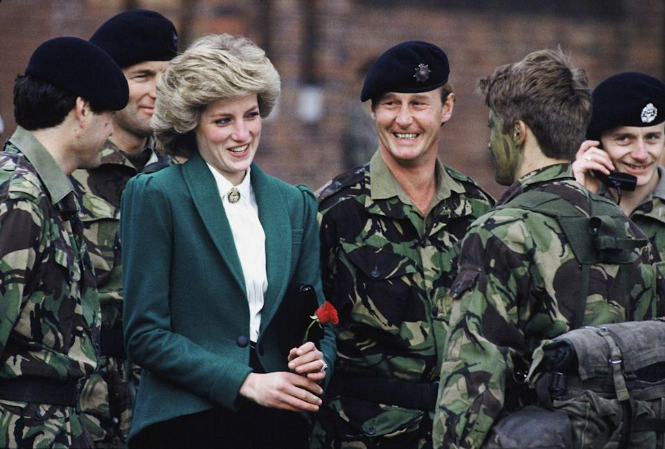 <p>On a work trip to Germany, the Princess of Wales, receives a red rose from a soldier.</p>