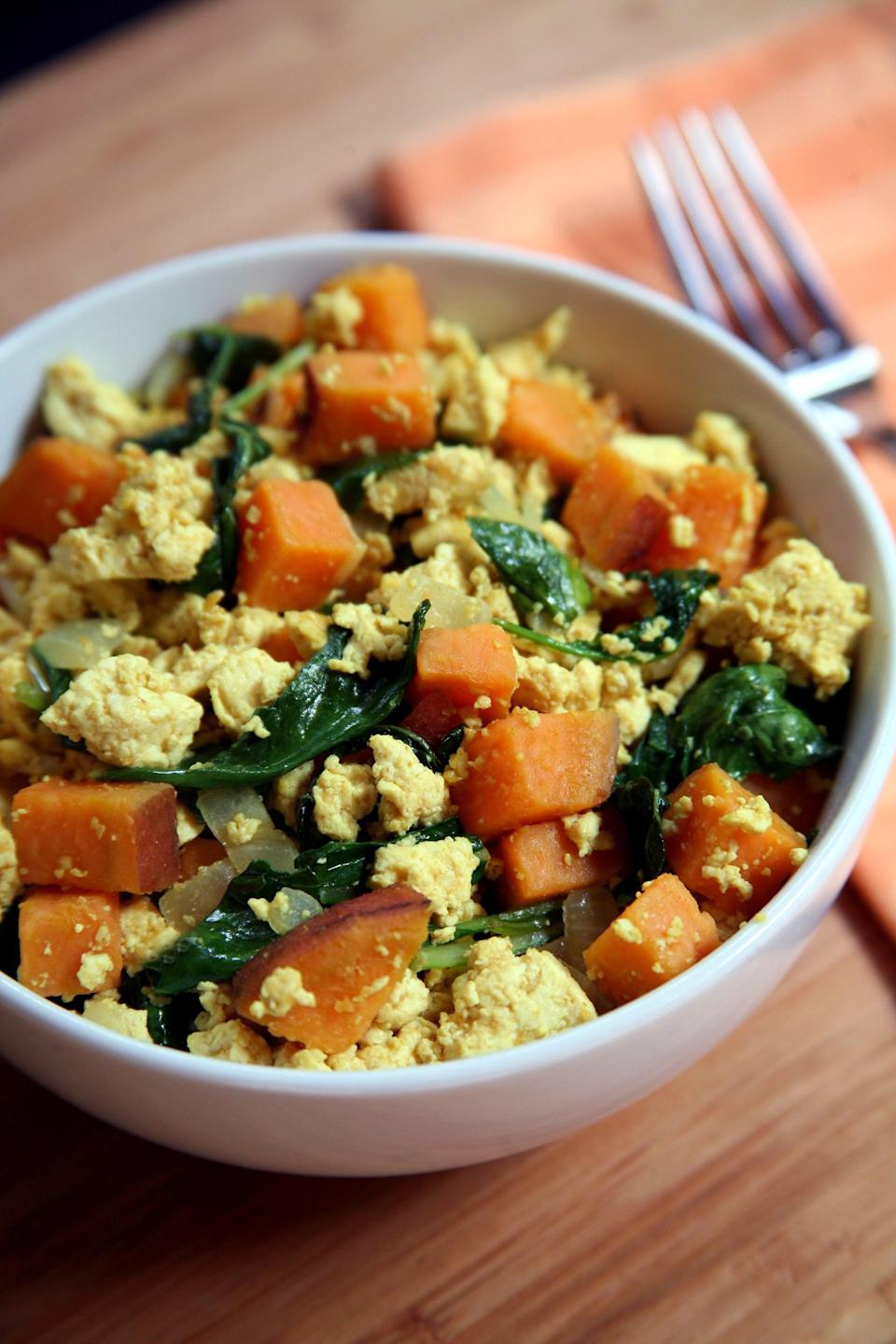"""<p>This tofu scramble is packed with protein: almost 19 grams for just under 270 calories. It could also make a great lunch or dinner.</p> <p><strong>Get the recipe:</strong> <a href=""""https://www.popsugar.com/fitness/Tofu-Scramble-Kale-Sweet-Potatoes-35566619"""" class=""""link rapid-noclick-resp"""" rel=""""nofollow noopener"""" target=""""_blank"""" data-ylk=""""slk:tofu scramble with kale and sweet potatoes"""">tofu scramble with kale and sweet potatoes</a></p>"""