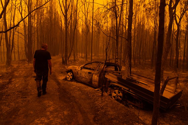 MOGO, Australia - December 31, 2019: Grant, a resident of the small town of Mogo on the NSW south coast, survived a devastating bushfire by submerging himself in a dam for an hour as the fires raged overhead, December 31, 2019. He was driving to his property when thick smoke forced him off the road and sent him crashing into a tree. The fires engulfed his car. (Photo by James Brickwood/The Sydney Morning Herald via Getty Images)