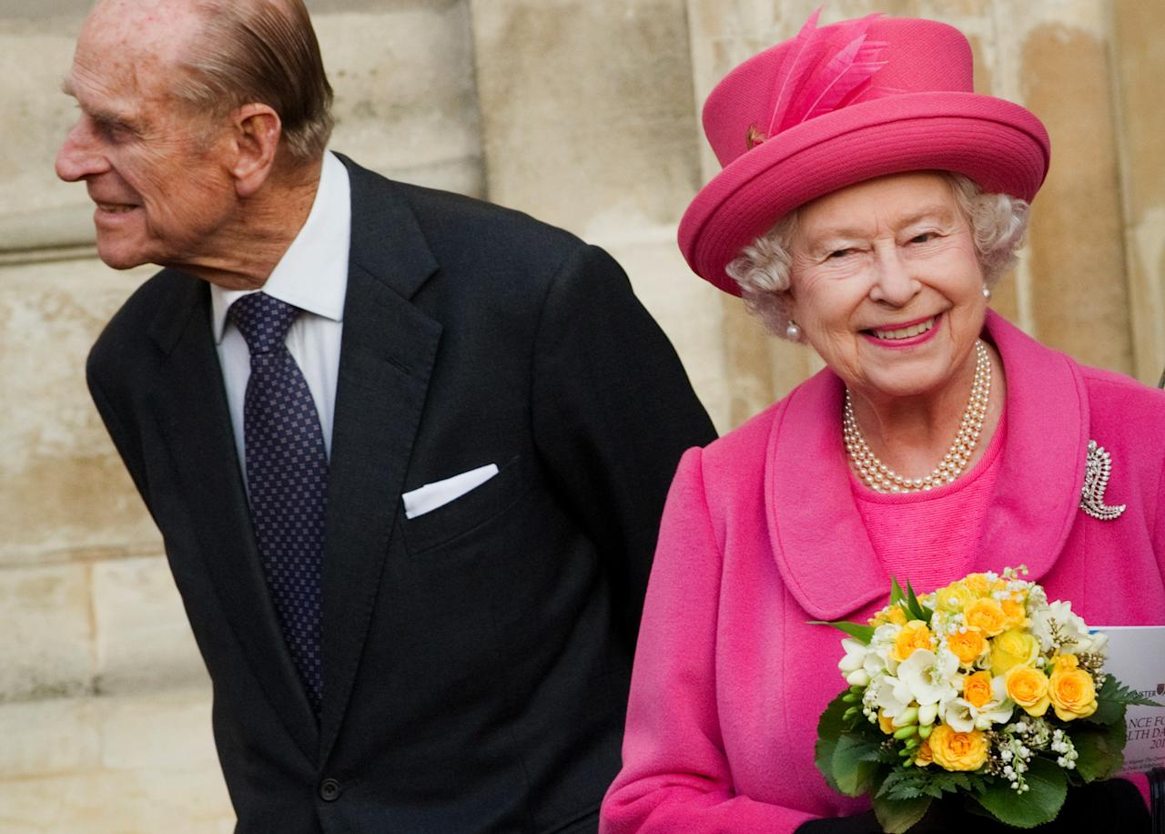 Prince Philip and Queen Elizabeth II leave following the Observance for Commonwealth Day service at Westminster Abbey in central London, Monday March 12, 2012. Queen Elizabeth II attended the service as head of the commonwealth of 54 member nations. (AP PHOTO / LEON NEAL)