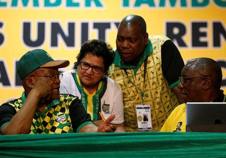 President of South Africa Zuma gestures as he speaks to Duarte Dr Mkhize and Deputy President of South Africa Ramaphosa during the 54th National Conference of the ruling African National Congress at the Nasrec Expo Centre in Johannesburg