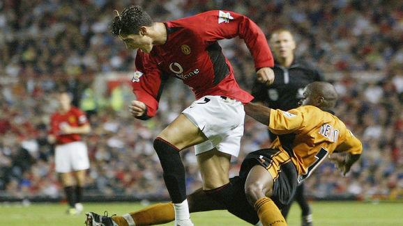Ronaldo of Man Utd tackled by Newton of Wolves