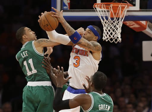 New York Knicks forward Kenyon Martin (3) grabs a rebound against Boston Celtics guard Courtney Lee (11) and forward Jeff Green during the second half of Game 1 of in the first round of the NBA basketball playoffs in New York, Saturday, April 20, 2013. The Knicks win 85-78. (AP Photo/Kathy Willens)