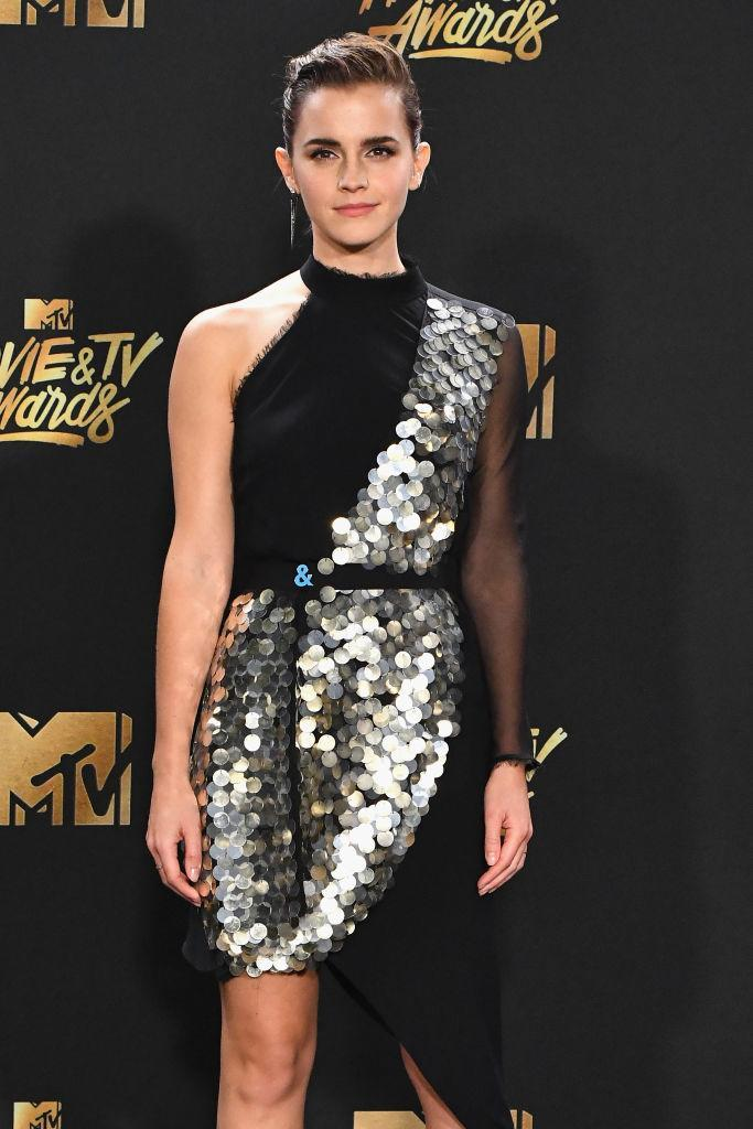 <p>Emma Watson was loud and proud with her support of GLAAD with an ampersand pin, that she donned with her Kitx dress to the MTV Awards. (Photo: Getty Images) </p>