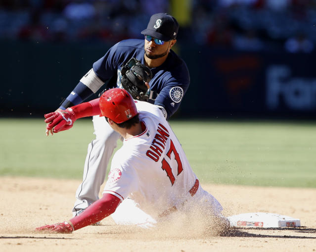 Seattle Mariners second baseman Robinson Cano, top, takes in the throw to tag out Los Angeles Angels' Shohei Ohtani trying to steal second during the eighth inning of a baseball game in Anaheim, Calif., Sunday, Sept. 16, 2018. (AP Photo/Alex Gallardo)