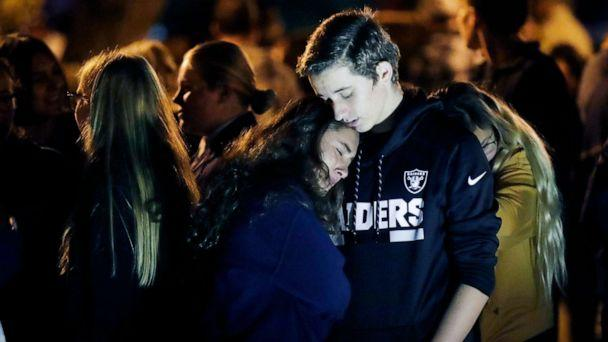 PHOTO: Hannah Schooping-Gutierrez, center, is comforted by her boyfriend Declan Sheridan, at right, a student at nearby Valencia High School during a vigil at Central Park in the aftermath of a shooting at Saugus Nov. 14, 2019, in Santa Clarita, Calif. (Marcio Jose Sanchez/AP)