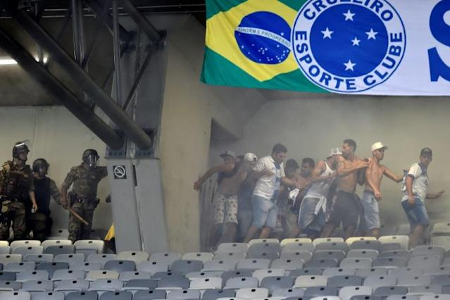 Trouble broke out towards the end of Cruzeiro's loss to Palmeiras that confirmed their relegation to the second tier (AFP Photo/DOUGLAS MAGNO)