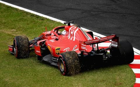 Sebastian Vettel of Germany driving the (5) Scuderia Ferrari SF71H kicks up grass after spinning during qualifying for the Formula One Grand Prix of Japan at Suzuka Circuit on October 6, 2018 in Suzuka - Credit: getty images