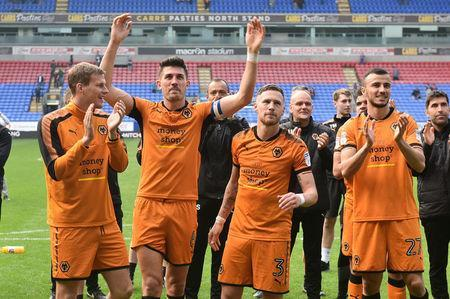Soccer Football - Championship - Bolton Wanderers v Wolverhampton Wanderers - Macron Stadium, Bolton, Britain - April 21, 2018 Wolverhampton Wanderers players celebrate winning the Championship Action Images/Paul Burrows