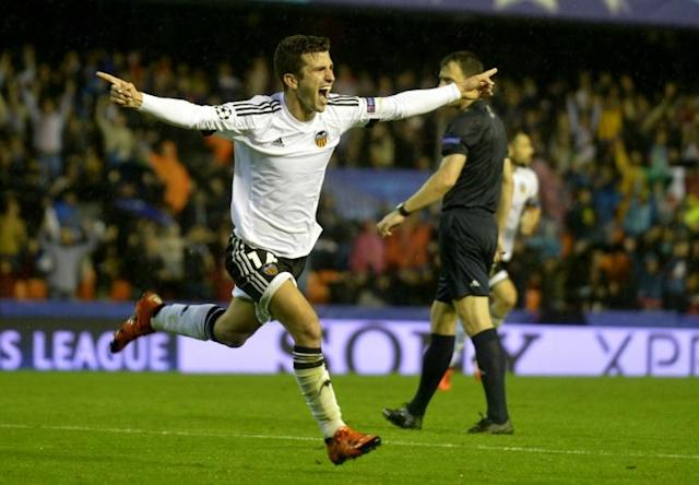 Valencia's defender Jose Gaya celebrates after scoring during the UEFA Champions League group H football match Valencia CF vs KAA Gent at the Mestalla stadium in Valencia on October 20, 2015