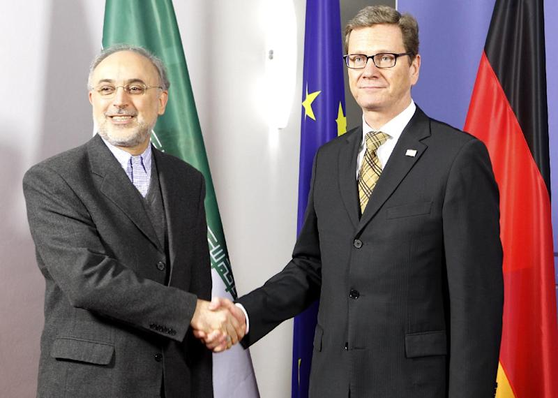 Iranian foreign minister Ali Akbar Salehi  left, shakes hands with German foreign minister Guido Westerwelle, right, at the International Afghanistan Conference in Bonn, Germany, Sunday Dec. 4, 2011. A global conference in Germany to discuss Afghanistan's future beyond 2014 comes as the country faces political instability, an enduring Taliban-led insurgency and possible financial collapse following the planned drawdown of international troops and foreign aid.  (AP Photo/dapd/Roberto Pfeil)