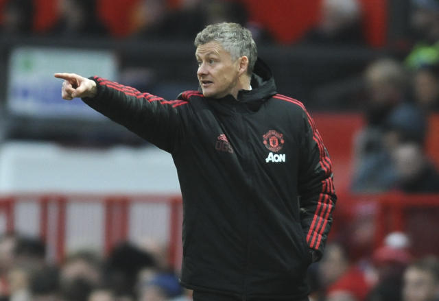 Manchester United manager Ole Gunnar Solskjær gives instructions during the English FA Cup third round soccer match between Manchester United and Reading at Old Trafford in Manchester, England, Saturday, Jan. 5, 2019. (AP Photo/Rui Vieira)