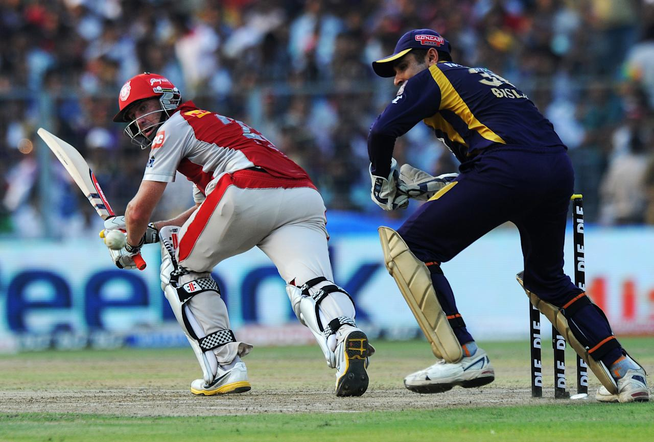Kings XI Punjab batsman David Hussey (L) looks back after playing a shot as Kolkata Knight Riders wicketkeeper Manvinder Bisla (R) reacts during the IPL Twenty20 cricket match between Kolkata Knight Riders and Kings XI Punjab at The Eden Gardens in Kolkata on April 15, 2012. RESTRICTED TO EDITORIAL USE. MOBILE USE WITHIN NEWS PACKAGE. AFP PHOTO/Dibyangshu SARKAR (Photo credit should read DIBYANGSHU SARKAR/AFP/Getty Images)