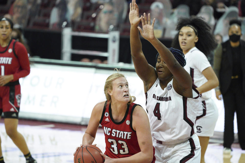North Carolina State center Elissa Cunane (33) looks for a shot against South Carolina forward Aliyah Boston (4) during the first half of an NCAA college basketball game Thursday, Dec. 3, 2020, in Columbia, S.C. (AP Photo/Sean Rayford)