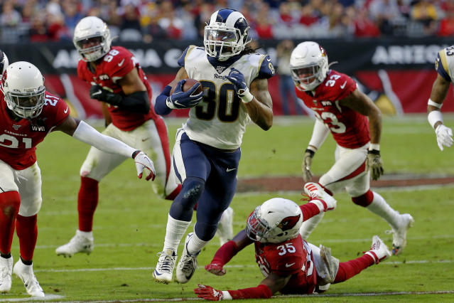 Los Angeles Rams running back Todd Gurley (30) eludes the reach of Arizona Cardinals safety Deionte Thompson (35) during the second half of an NFL football game, Sunday, Dec. 1, 2019, in Glendale, Ariz. (AP Photo/Rick Scuteri)
