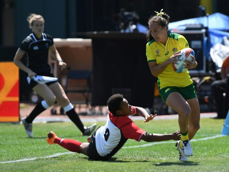 Evania Pelite of Australia scores a try in a 34-5 win over Papua New Guinea, during their women's round of 16 games at the Rugby Sevens World Cup in San Francisco