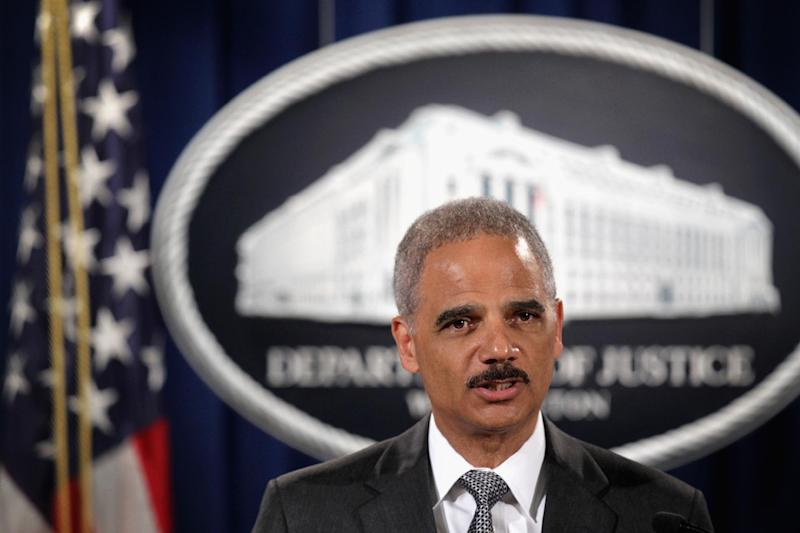 Attorney General Eric Holder makes a statement at a press conference at the Justice Department in Washington, DC on August 21, 2014 (AFP Photo/Alex Wong)