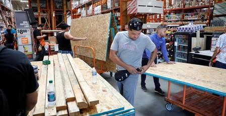 Local residents get supplies ahead of the arrival of Hurricane Dorian in Kissimmee