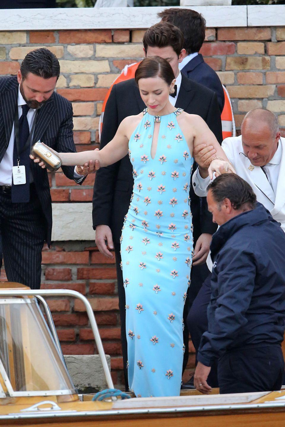 <p>If you've seen any snaps from Amal and George Clooney's wedding then you'll know Emily Blunt's pale blue floor-length gown fitted in with the glamour perfectly.</p>
