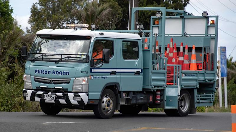 Road traffic cone laying truck in Auckland New Zealand
