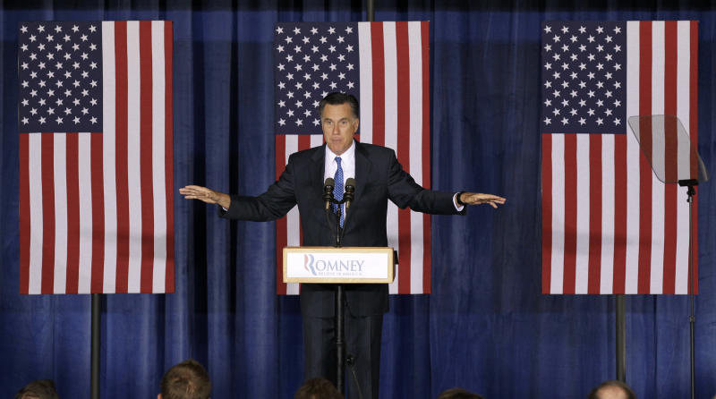 """In this May 15, 2012, photo, Republican presidential candidate, former Massachusetts Gov. Mitt Romney speaks during a campaign stop in Des Moines, Iowa. When Republican Romney decried the """"prairie fire"""" of U.S. debt Tuesday, he ignored some of the sparks that set it ablaze. One was the Great Recession that took hold before Barack Obama became president. That landmark event went unmentioned in Romney's speech. Another was a series of Bush-era tax cuts that Romney wants to follow with even lower rates.  (AP Photo/Charlie Neibergall)"""