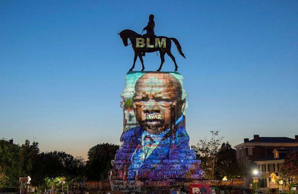 PHOTO: The image of late Rep. John Lewis, a pioneer of the civil rights movement and long-time member of the U.S. House of Representatives, is projected on the statue of Confederate General Robert E. Lee in Richmond, Va., July 19, 2020. (Jay Paul/Reuters)