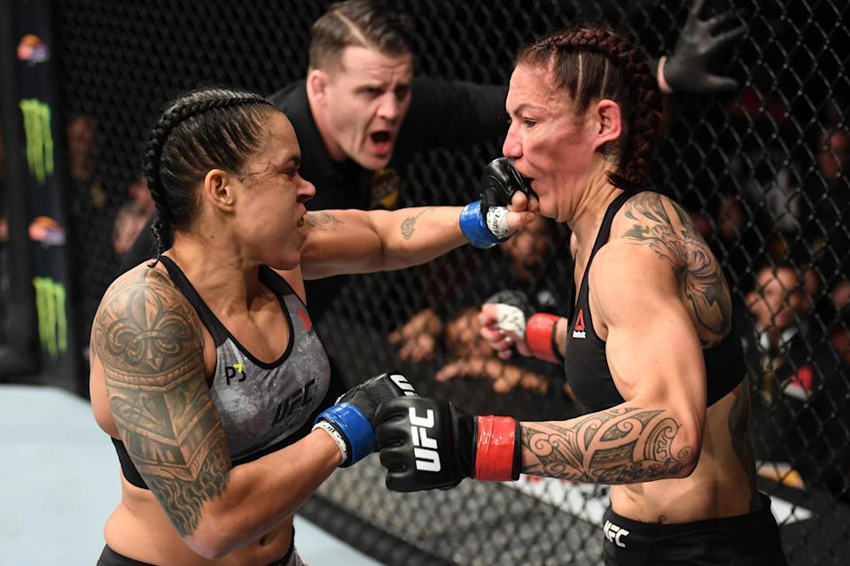 Amanda Nunes of Brazil punches Cris Cyborg of Brazil in their women's featherweight bout during the UFC 232 event inside The Forum on December 29, 2018 in Inglewood, California. (Getty Images)