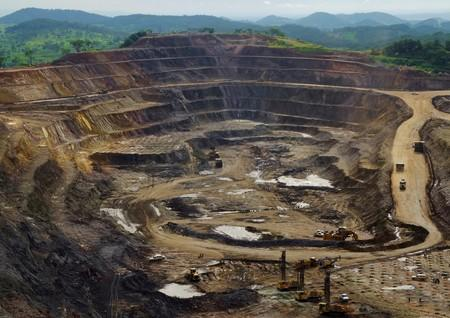 FILE PHOTO: Excavators and drillers at work in an open pit at Tenke Fungurume, a copper and cobalt mine northwest of Lubumbashi in Congo's copper-producing south