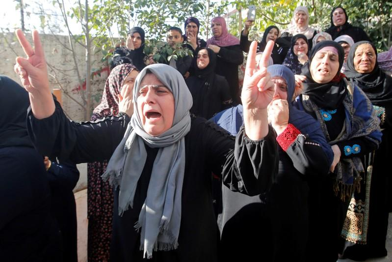 Relative of Palestinian man Omar al-Badawi reacts during his funeral in al-Arroub refugee camp, in the Israeli-occupied West Bank