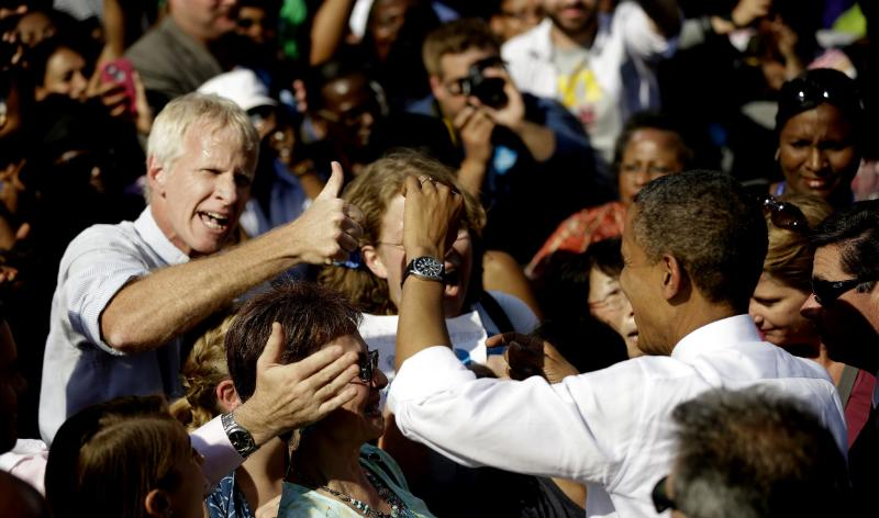 An unidentified supporter gives President Barack Obama a 'thumbs-up' at a campaign event at the Carillon at Byrd Park, Thursday, Oct. 25, 2012, in Richmond Va. The president is on the second day of his 48 hour, 8 State campaign blitz. (AP Photo/Pablo Martinez Monsivais)