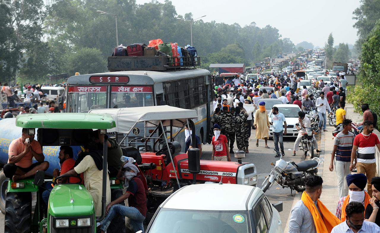 Farmers arrive to protest against the Electricity Amendment Bill 2020 and agriculture reforms bills passed in the Parliament, at NH-7 Delhi-Amritsar Highway, at Shambhu Border, on September 25, 2020 in Patiala, India. The two bills - the Farmers (Empowerment and Protection) Agreement on Price Assurance and Farm Services Bill, 2020 and the Farming Produce Trade and Commerce (Promotion and Facilitation) Bill, 2020 - were passed by the Rajya Sabha despite uproar and strong protest by the Opposition parties in the house. (Photo by Bharat Bhushan/Hindustan Times via Getty Images)