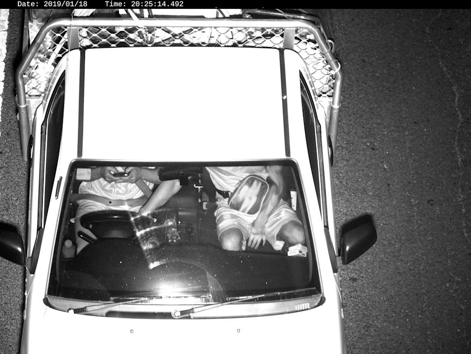 A driver using a device caught by a Mobile Phone Detection Camera. The image was released by Transport for NSW.