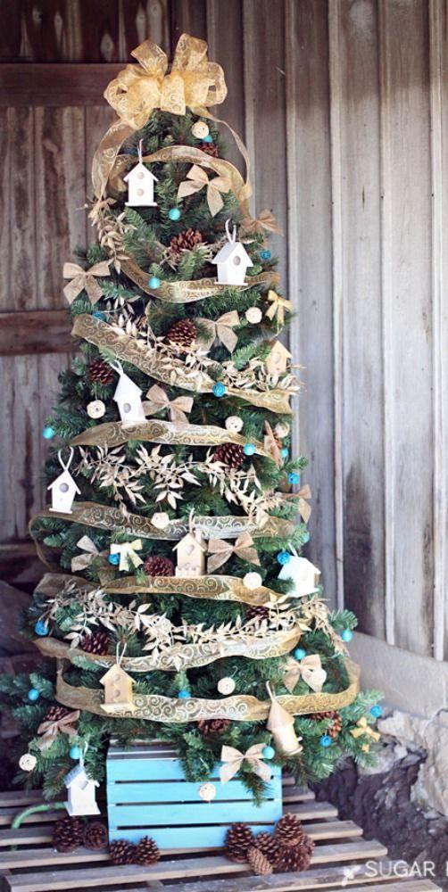 """<p>No birds here: This tree is full of birdhouse ornaments and leafy garland for an au naturel look. </p><p><em><a href=""""http://www.sugarbeecrafts.com/2014/11/themed-christmas-tree-home-tweet-home.html"""" rel=""""nofollow noopener"""" target=""""_blank"""" data-ylk=""""slk:See more at Sugar Bee Crafts »"""" class=""""link rapid-noclick-resp"""">See more at Sugar Bee Crafts »</a></em></p>"""