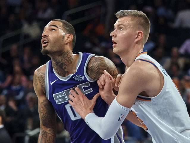 "<a class=""link rapid-noclick-resp"" href=""/nba/players/5466/"" data-ylk=""slk:Willie Cauley-Stein"">Willie Cauley-Stein</a> looks at himself and <a class=""link rapid-noclick-resp"" href=""/nba/players/5464/"" data-ylk=""slk:Kristaps Porzingis"">Kristaps Porzingis</a> and sees his shortcomings. (AP Photo/Andres Kudacki)"