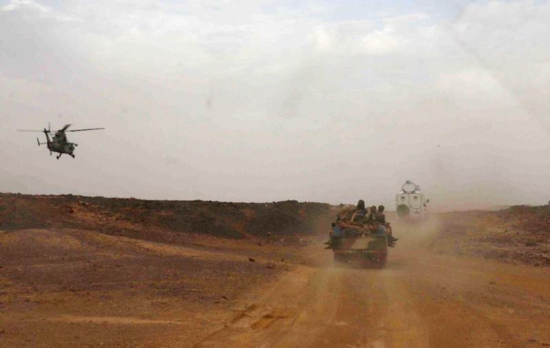 A helicopter guards an official car on the road from Gao to Kidal in Mali (AFP Photo/Fabien Offner)