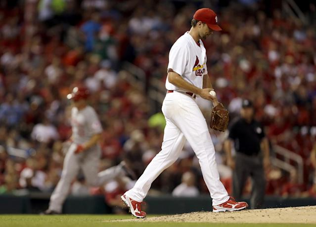 St. Louis Cardinals starting pitcher Adam Wainwright, right, walks back to the mound after giving up a three-run home run to Cincinnati Reds' Jay Bruce, left, during the second inning of a baseball game Wednesday, Aug. 28, 2013, in St. Louis. (AP Photo/Jeff Roberson)