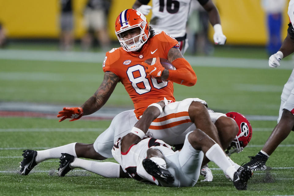 Clemson tight end Braden Galloway is brought down by Georgie defenders during the second half of an NCAA college football game Saturday, Sept. 4, 2021, in Charlotte, N.C. (AP Photo/Chris Carlson)