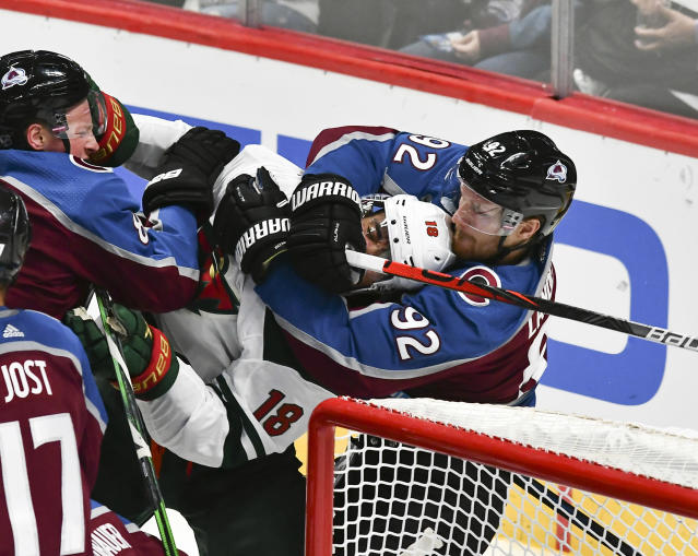 Colorado Avalanche left wing Gabriel Landeskog (92) grabs Minnesota Wild left wing Jordan Greenway (18) from behind during the third period of an NHL preseason hockey game, Sunday, Sept. 22, 2019, in Denver. Colorado won 3-2 in a shootout. (AP Photo/John Leyba)