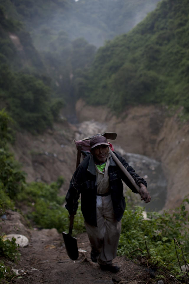 "In this photo taken on Monday Oct. 5, 2011, Tomas Perez Hernandez, 67, carries sacks of metals he collected after working the entire day at the bottom of one of the biggest trash dumps in the city, known as ""The Mine,"" in Guatemala City. Tomas has worked collecting metal from ""The Mine"" for more than 40 years. Hundreds of informal workers descend daily into the mounds of the landfill and the rushing waters that come from a storm tunnel and a sewer at the bottom of a gorge to search for scrap metal to sell. This activity known locally as ""mining"" is extremely dangerous due to mud slides and collapses, but earns many of them about 150 quetzals ($20 dollars) a day, nearly twice the minimum daily wage. AP Photo/Rodrigo Abd)"