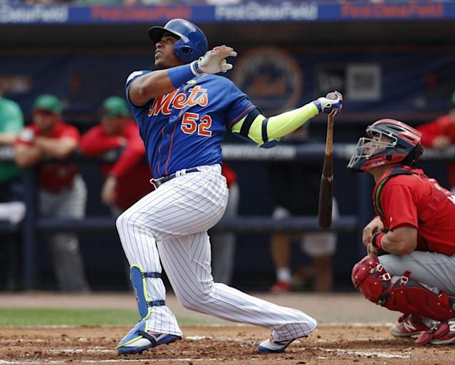 Yoenis Cespedes is back with the Mets after signing another big contract. (AP)