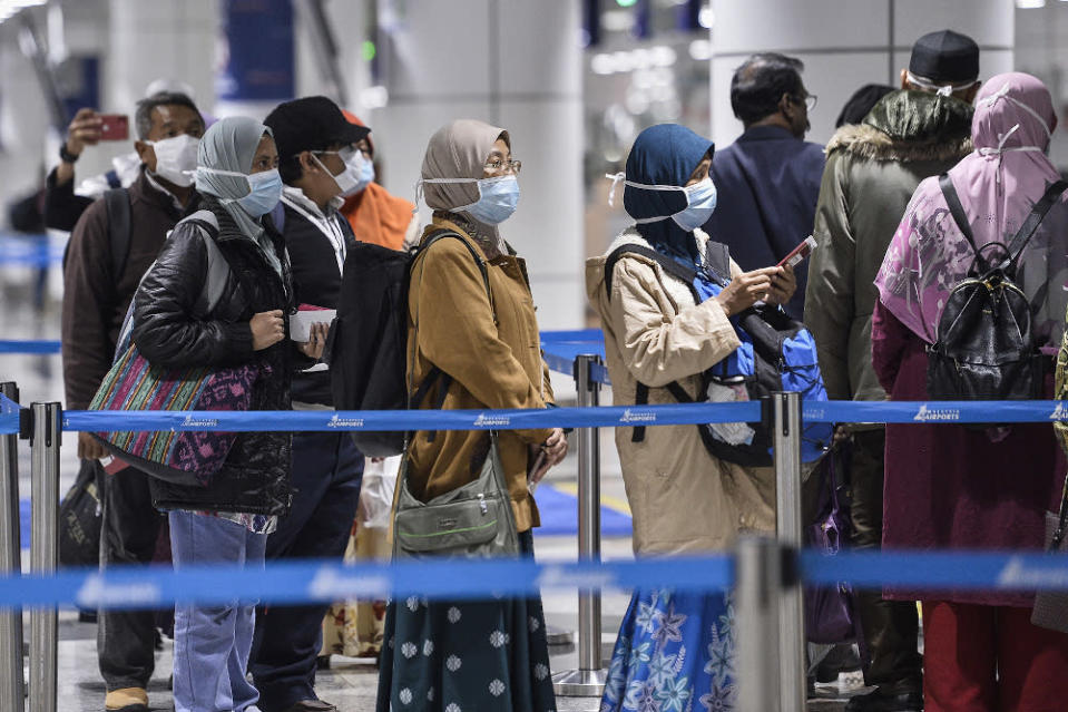 Passengers wearing masks are pictured at KLIA March 10, 2020. — Picture by Miera Zulyana