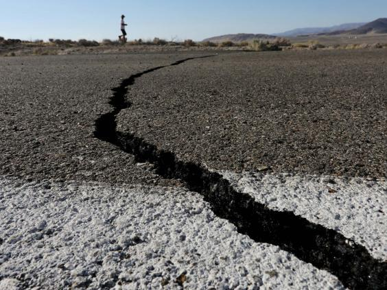 Fissures that opened up under a highway during a powerful earthquake that struck Southern California are seen near the city of Ridgecrest (REUTERS)