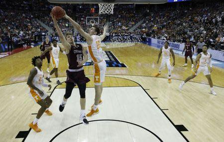 Mar 22, 2019; Columbus, OH, USA; Tennessee Volunteers forward John Fulkerson (10) blocks a shot from Colgate Raiders guard Tucker Richardson (15) in the first half in the first round of the 2019 NCAA Tournament at Nationwide Arena. Mandatory Credit: Rick Osentoski-USA TODAY Sports