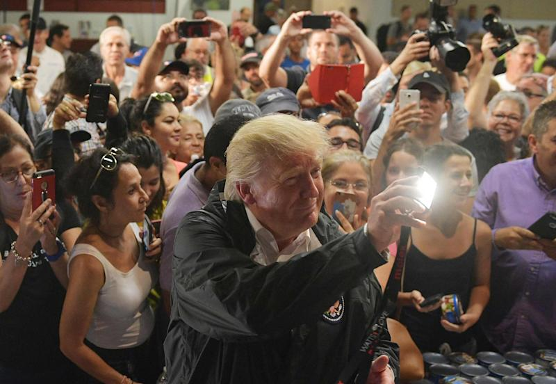 The President received a warm reception at a church where aide was being distributed: AFP/Getty Images
