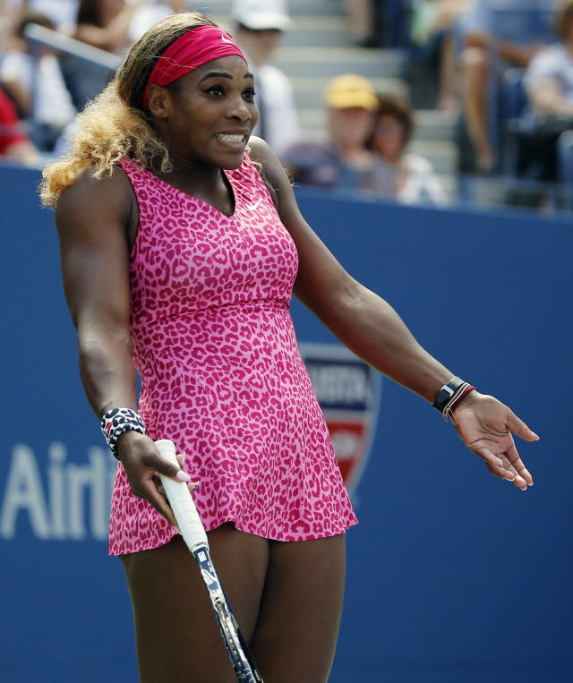 Serena Williams, of the United States, reacts after a shot against Vania King, of the United States, during the second round of the 2014 U.S. Open tennis tournament, Thursday, Aug. 28, 2014, in New York. (AP Photo/Elise Amendola)
