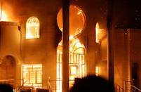 Fire rips through the Iranian consulate in Basra on September 7, 2018, during protests over a crisis in public services and alleged corruption among Iraqi officials