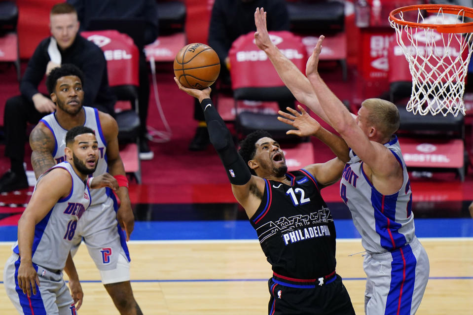 Philadelphia 76ers' Tobias Harris (12) goes up for a shot against Detroit Pistons' Mason Plumlee (24) during the second half of an NBA basketball game, Saturday, May 8, 2021, in Philadelphia. (AP Photo/Matt Slocum)