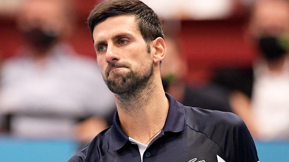 Seen here, a sad Novak Djokovic suffered his worst two-set loss to Lorenzo Sonego in Vienna.